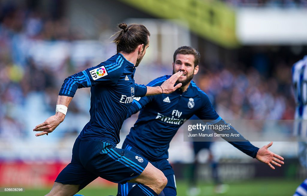 Gareth Bale of Real Madrid celebrates after scoring goal during the La Liga match between Real Sociedad de Futbol and Real Madrid at Estadio Anoeta on April 30, 2016 in San Sebastian, Spain.