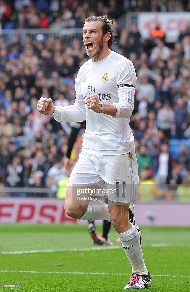 Gareth Bale of Real Madrid celebrates after scoring his team's 2nd goal during the La Liga match between Real Madrid and Rayo Vallecano at estadio Santiago Bernabeu on December 20, 2015 in Madrid, Spain.