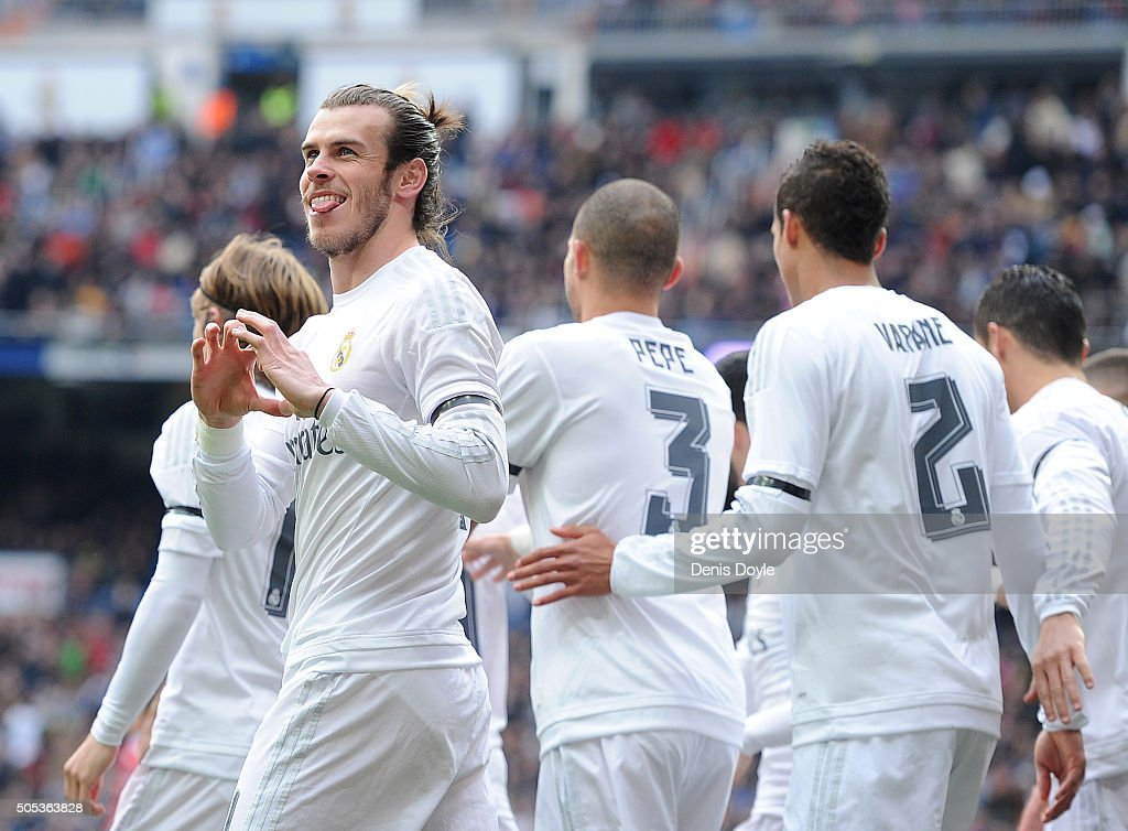 Gareth Bale of Real Madrid celebrates after scoring his team's opening goal during the La Liga match between Real Madrid CF and Sporting Gijon at Estadio Santiago Bernabeu on January 17, 2016 in Madrid, Spain.