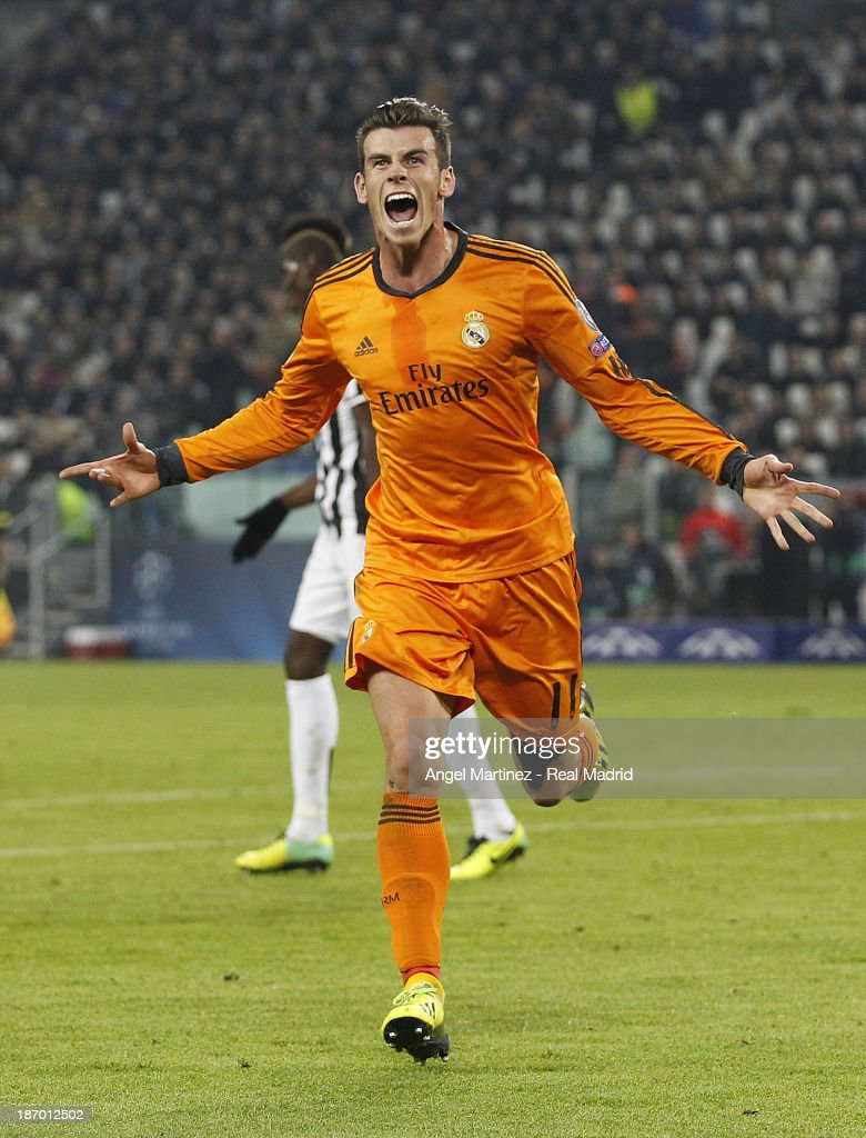 <a gi-track='captionPersonalityLinkClicked' href=/galleries/search?phrase=Gareth+Bale&family=editorial&specificpeople=609290 ng-click='$event.stopPropagation()'>Gareth Bale</a> of Real Madrid celebrates after scoring his team's second goal during the UEFA Champions League Group B match between Juventus and Real Madrid at Juventus Arena on November 5, 2013 in Turin, Italy.