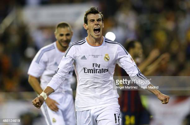 Gareth Bale of Real Madrid celebrates after scoring his team's second goal during the Copa del Rey Final between Real Madrid and Barcelona at Estadio...