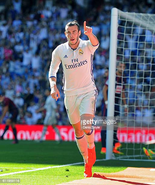 Gareth Bale of Real Madrid celebrates after scoring Real's opening goal during the La Liga Match between Real Madrid CF and SD Eibar at estadio...