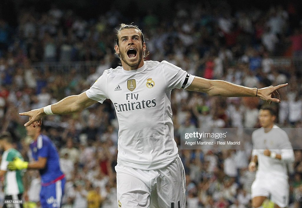 Gareth Bale of Real Madrid celebrates after scoring the opening goal during the La Liga match between Real Madrid CF and Real Betis Balompie at Estadio Santiago Bernabeu on August 29, 2015 in Madrid, Spain.