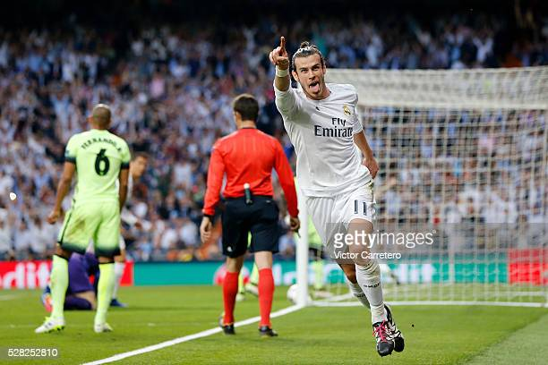 Gareth Bale of Real Madrid celebrates after scoring the opening goal during the UEFA Champions League Semi Final second leg match between Real Madrid...