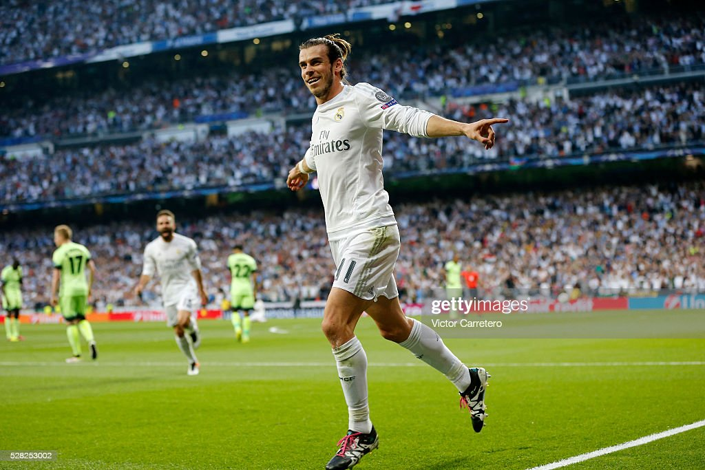 Gareth Bale of Real Madrid celebrates after scoring the opening goal during the UEFA Champions League Semi Final second leg match between Real Madrid and Manchester City FC at Estadio Santiago Bernabeu on May 4, 2016 in Madrid, Spain.