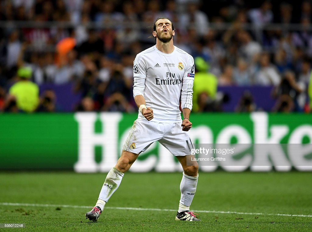 <a gi-track='captionPersonalityLinkClicked' href=/galleries/search?phrase=Gareth+Bale&family=editorial&specificpeople=609290 ng-click='$event.stopPropagation()'>Gareth Bale</a> of Real Madrid celebrates after scoring the penalty past Jan Oblak of Atletico Madrid during the UEFA Champions League Final match between Real Madrid and Club Atletico de Madrid at Stadio Giuseppe Meazza on May 28, 2016 in Milan, Italy.