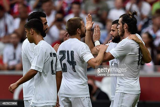 Gareth Bale of Real Madrid celebrates as he scores the second goal during the Audi Cup 2015 match between Real Madrid and Tottenham Hotspur at...