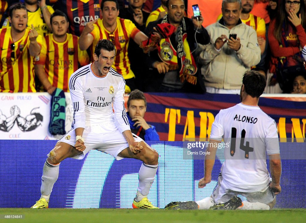 Gareth Bale (L) of Real Madrid celebrates beside Xabi Alonso after scoring Real's 2nd goal during the Copa del Rey Final between Real Madrid and Barcelona at Estadio Mestalla on April 16, 2014 in Valencia, Spain.