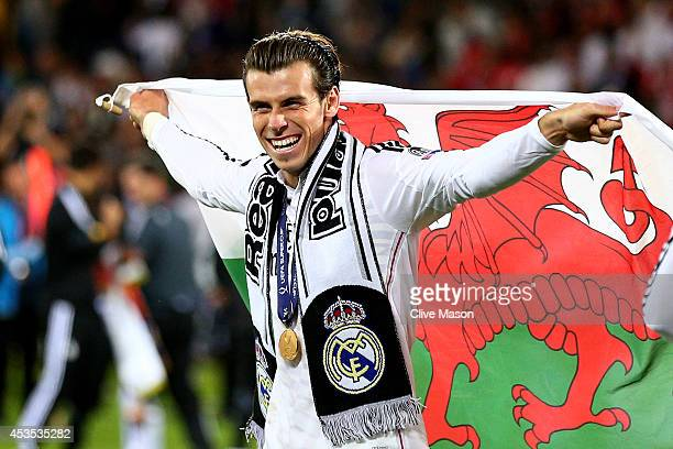 Gareth Bale of Real Madrid celebrates following his team's 20 victory during the UEFA Super Cup between Real Madrid and Sevilla FC at Cardiff City...