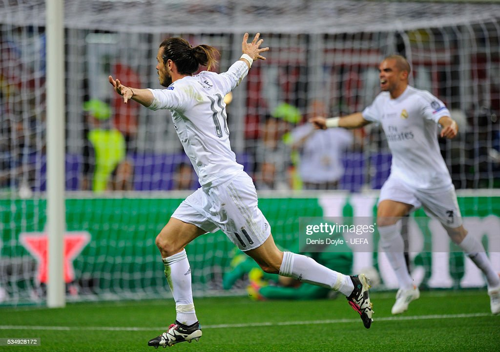 <a gi-track='captionPersonalityLinkClicked' href=/galleries/search?phrase=Gareth+Bale&family=editorial&specificpeople=609290 ng-click='$event.stopPropagation()'>Gareth Bale</a> of Real Madrid celebrates his team's first goal during the UEFA Champions League Final between Real Madrid and Club Atletico de Madrid at Stadio Giuseppe Meazza on May 28, 2016 in Milan, Italy.