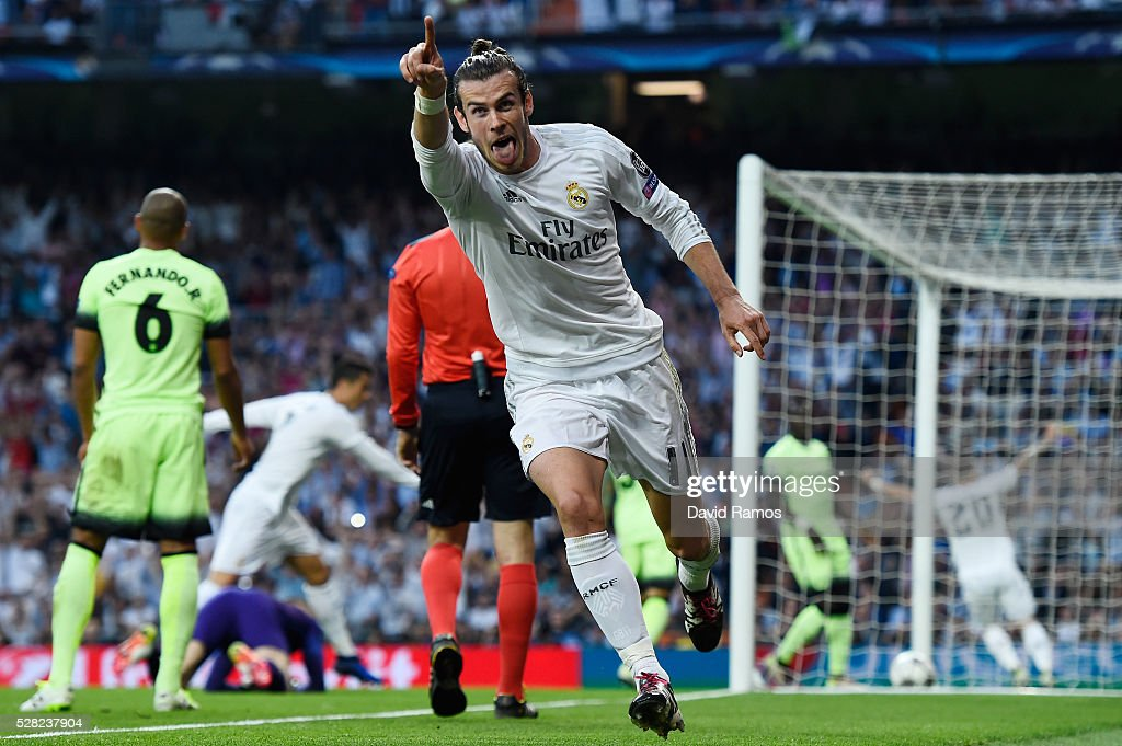 Gareth Bale of Real Madrid celebrates scoring the opening goal during the UEFA Champions League semi final, second leg match between Real Madrid and Manchester City FC at Estadio Santiago Bernabeu on May 4, 2016 in Madrid, Spain.