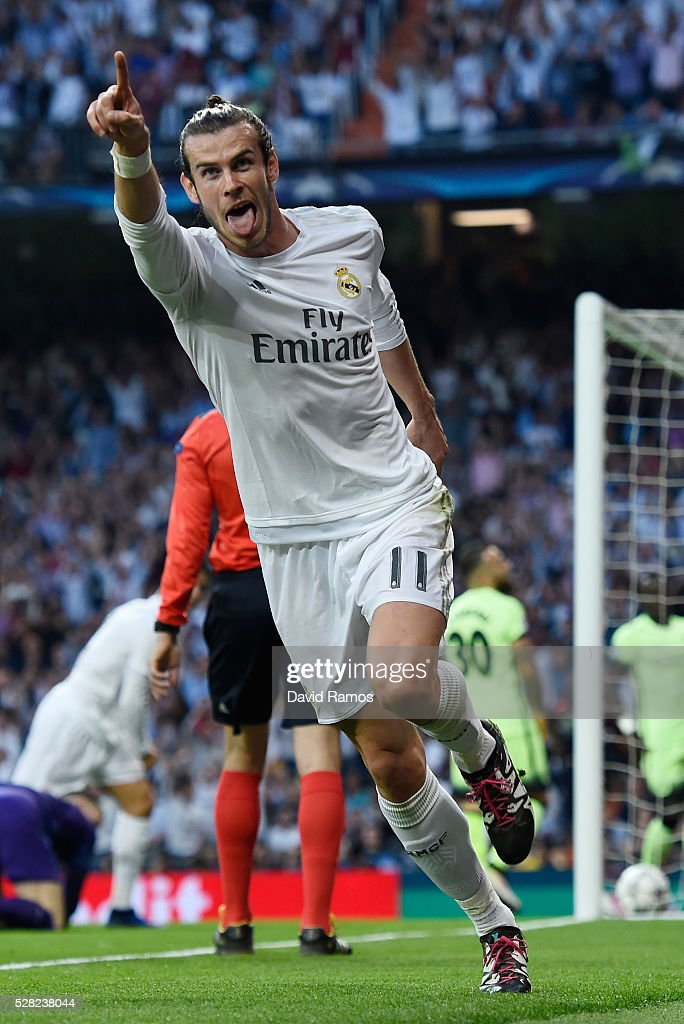 <a gi-track='captionPersonalityLinkClicked' href=/galleries/search?phrase=Gareth+Bale&family=editorial&specificpeople=609290 ng-click='$event.stopPropagation()'>Gareth Bale</a> of Real Madrid celebrates scoring the opening goal during the UEFA Champions League semi final, second leg match between Real Madrid and Manchester City FC at Estadio Santiago Bernabeu on May 4, 2016 in Madrid, Spain.
