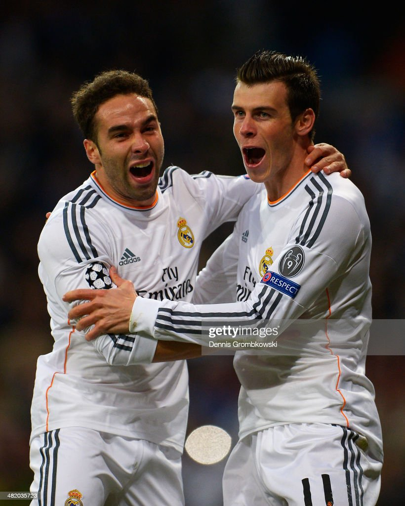 <a gi-track='captionPersonalityLinkClicked' href=/galleries/search?phrase=Gareth+Bale&family=editorial&specificpeople=609290 ng-click='$event.stopPropagation()'>Gareth Bale</a> (R) of Real Madrid celebrates scoring the opening goal with Daniel Carvajal of Real Madrid during the UEFA Champions League Quarter Final first leg match between Real Madrid and Borussia Dortmund at Estadio Santiago Bernabeu on April 2, 2014 in Madrid, Spain.