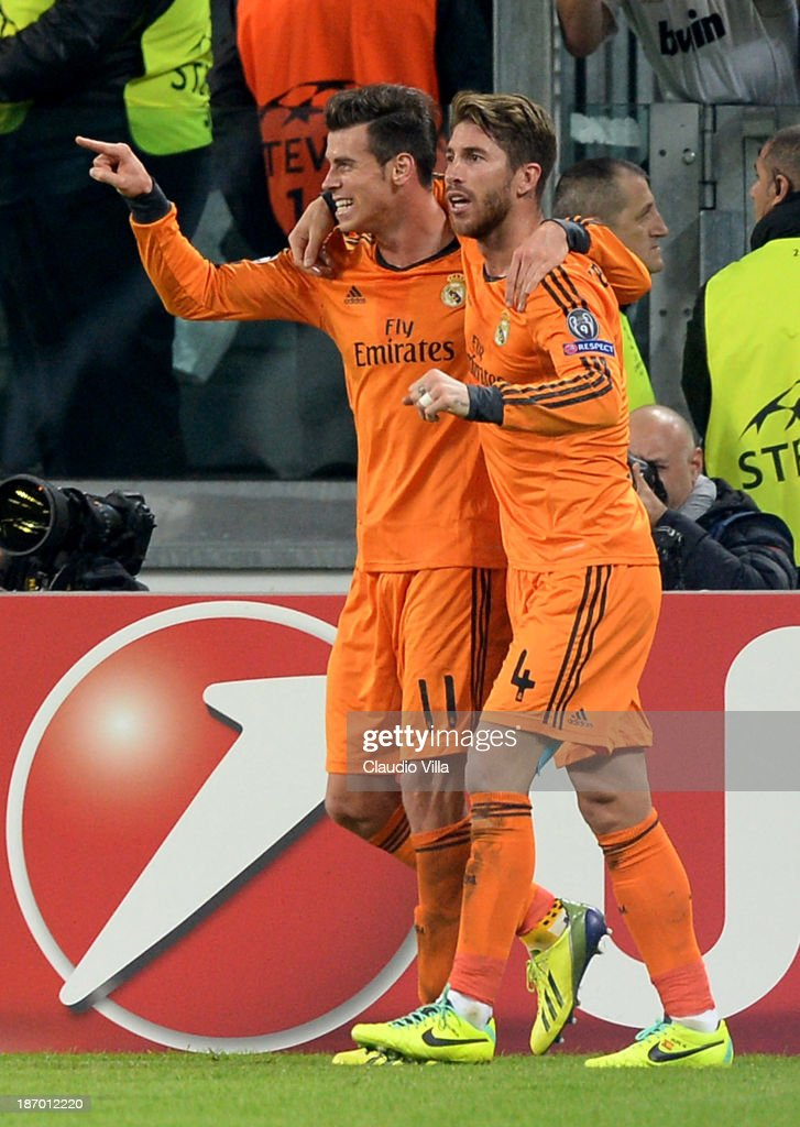 <a gi-track='captionPersonalityLinkClicked' href=/galleries/search?phrase=Gareth+Bale&family=editorial&specificpeople=609290 ng-click='$event.stopPropagation()'>Gareth Bale</a> of Real Madrid (L) celebrates scoring the second goal during the UEFA Champions League Group B match between Juventus and Real Madrid at Juventus Arena on November 5, 2013 in Turin, Italy.