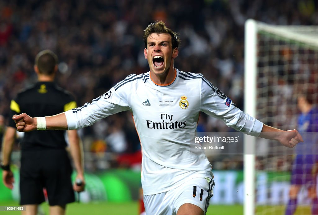 Gareth Bale of Real Madrid celebrates scoring their second goal in extra time during the UEFA Champions League Final between Real Madrid and Atletico de Madrid at Estadio da Luz on May 24, 2014 in Lisbon, Portugal.