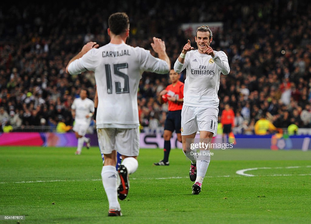 <a gi-track='captionPersonalityLinkClicked' href=/galleries/search?phrase=Gareth+Bale&family=editorial&specificpeople=609290 ng-click='$event.stopPropagation()'>Gareth Bale</a> of Real Madrid (R) celebrates with Daniel Carvajal as he scores their second goal during the La Liga match between Real Madrid CF and RC Deportivo La Coruna at Estadio Santiago Bernabeu on January 9, 2016 in Madrid, Spain.