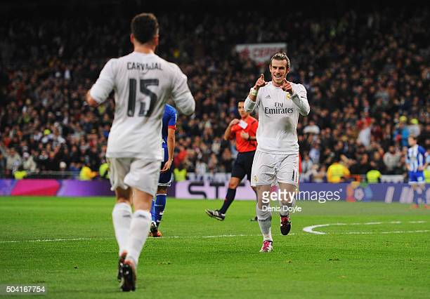 Gareth Bale of Real Madrid celebrates with Daniel Carvajal as he scores their second goal during the La Liga match between Real Madrid CF and RC...