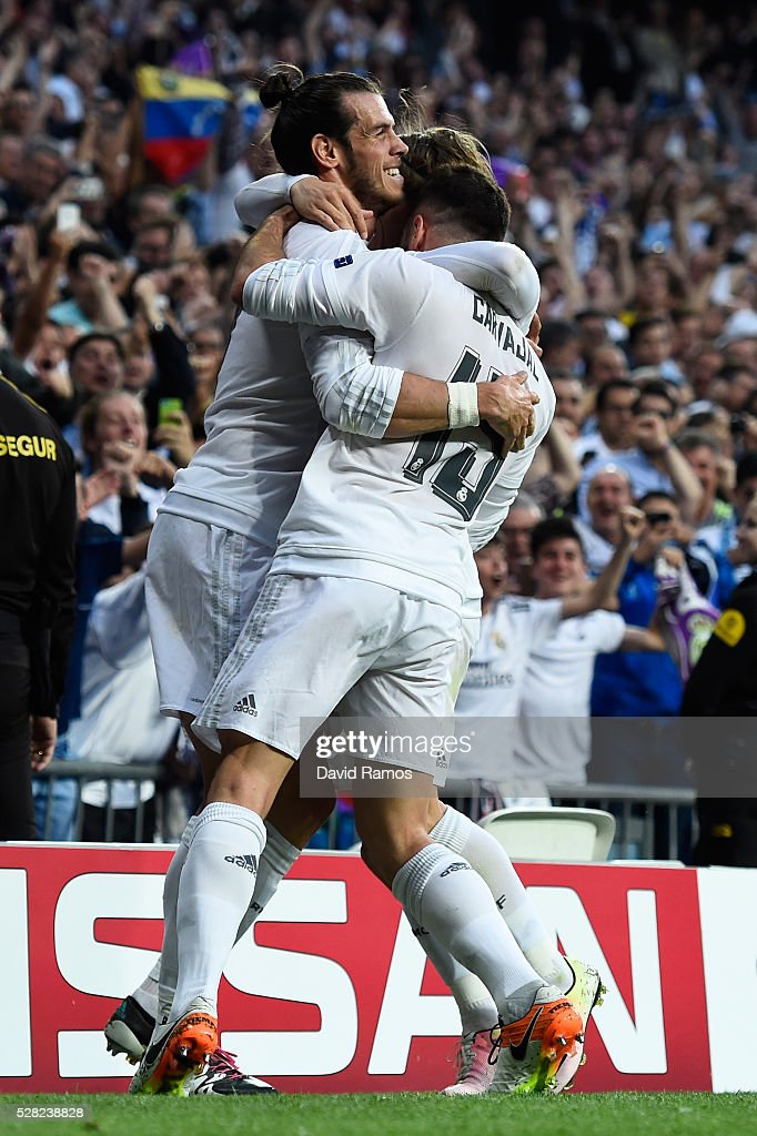 Gareth Bale of Real Madrid celebrates with Daniel Carvajal of Real Madrid and Luka Modric of Real Madrid scoring the opening goal during the UEFA Champions League semi final, second leg match between Real Madrid and Manchester City FC at Estadio Santiago Bernabeu on May 4, 2016 in Madrid, Spain.