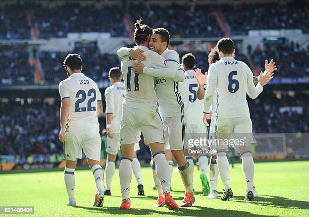 Gareth Bale of Real Madrid celebrates with Rafael Varane after scoring his 2nd goal during the Liga match between Real Madrid CF and Leganes on...