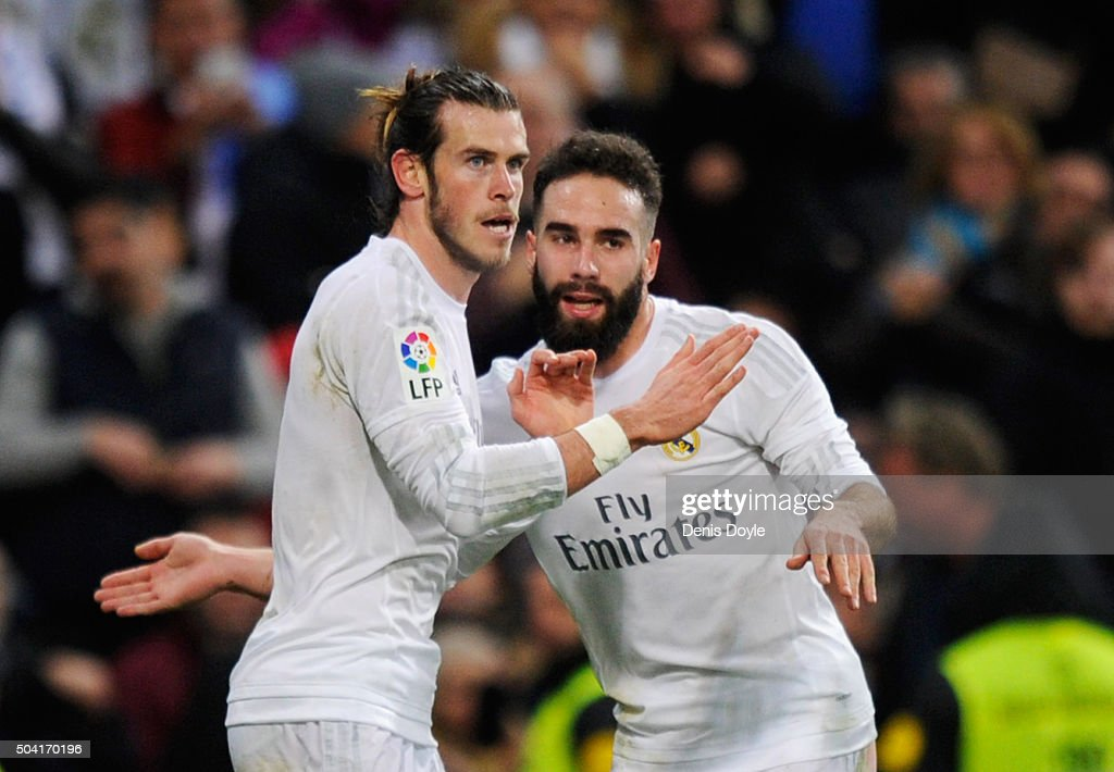 <a gi-track='captionPersonalityLinkClicked' href=/galleries/search?phrase=Gareth+Bale&family=editorial&specificpeople=609290 ng-click='$event.stopPropagation()'>Gareth Bale</a> of Real Madrid (L) celebrates with team mate Daniel Carvajal as he scores their fourth goaland completes his hat trick during the La Liga match between Real Madrid CF and RC Deportivo La Coruna at Estadio Santiago Bernabeu on January 9, 2016 in Madrid, Spain.