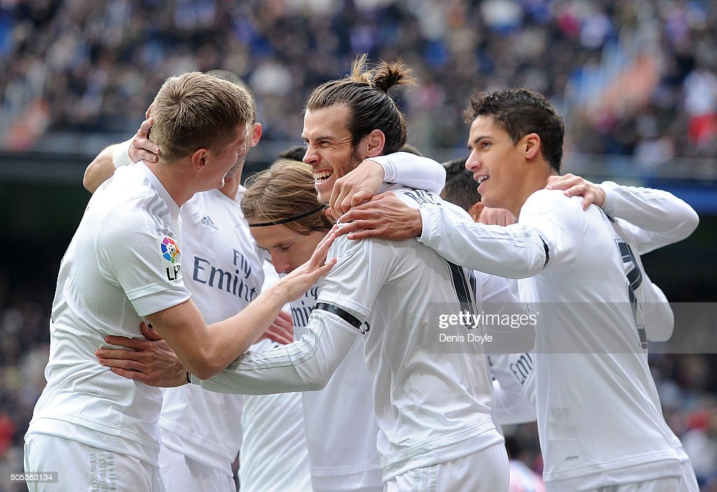 Gareth Bale of Real Madrid celebrates with team mates after scoring his team's opening goal during the La Liga match between Real Madrid CF and Sporting Gijon at Estadio Santiago Bernabeu on January 17, 2016 in Madrid, Spain.