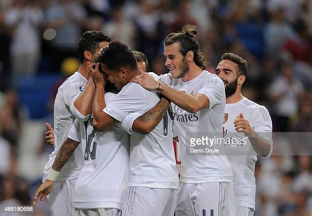 Gareth Bale of Real Madrid celebrates with teammates after Marcelo scored Real's 2nd goal during the Santiago Bernabeu Trophy match between Real...