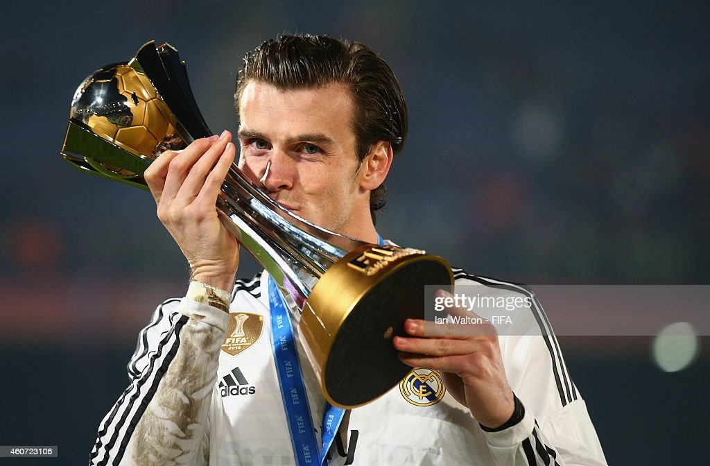 <a gi-track='captionPersonalityLinkClicked' href=/galleries/search?phrase=Gareth+Bale&family=editorial&specificpeople=609290 ng-click='$event.stopPropagation()'>Gareth Bale</a> of Real Madrid celebrates with the trophy after the FIFA Club World Cup Final between Real Madrid and San Lorenzo at Marrakech Stadium on December 20, 2014 in Marrakech, Morocco.