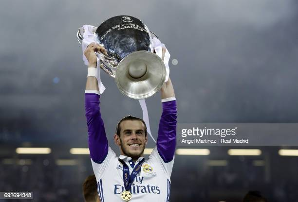 Gareth Bale of Real Madrid celebrates with the trophy after the UEFA Champions League Final match between Juventus and Real Madrid at National...