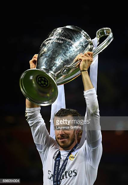 Gareth Bale of Real Madrid celebrates with the trophy after victory in the UEFA Champions League Final match between Real Madrid and Club Atletico de...
