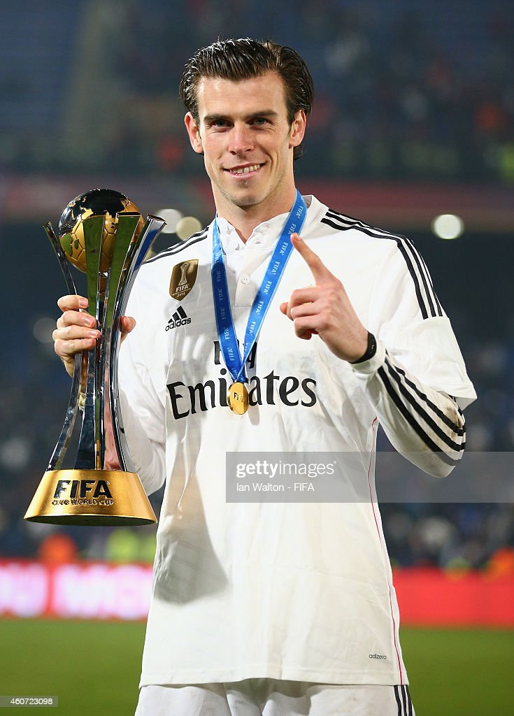 <a gi-track='captionPersonalityLinkClicked' href=/galleries/search?phrase=Gareth+Bale&family=editorial&specificpeople=609290 ng-click='$event.stopPropagation()'>Gareth Bale</a> of Real Madrid celebrates withe the trophy after the FIFA Club World Cup Final between Real Madrid and San Lorenzo at Marrakech Stadium on December 20, 2014 in Marrakech, Morocco.