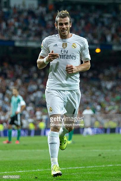 Gareth Bale of Real Madrid CF celebrates scoring their fifth goal during the La Liga match between Real Madrid CF and Real Betis Balompie at Estadio...