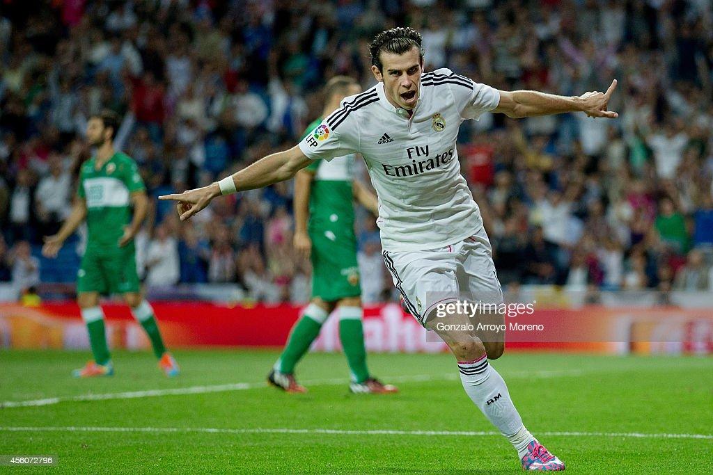 Gareth Bale of Real Madrid CF celebrates scoring their opening goal during the La Liga match between Real Madrid CF and Elche CF at Estadio Santiago...