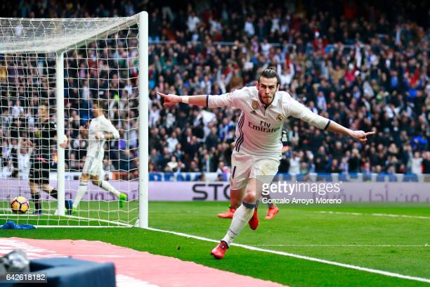 Gareth Bale of Real Madrid CF celebrates scoring their second goal during the La Liga match between Real Madrid CF and RCD Espanyol at Estadio...