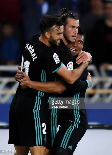 Gareth Bale of Real Madrid CF celebrates with his team mates Borja Mayoral and Carlos Enrique Casimiro after scoring his team's third goal during the...