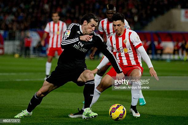 Gareth Bale of Real Madrid CF competes for the ball with Joaquin Navarro JImenez of Almeria UD during the La Liga match between UD Almeria and Real...