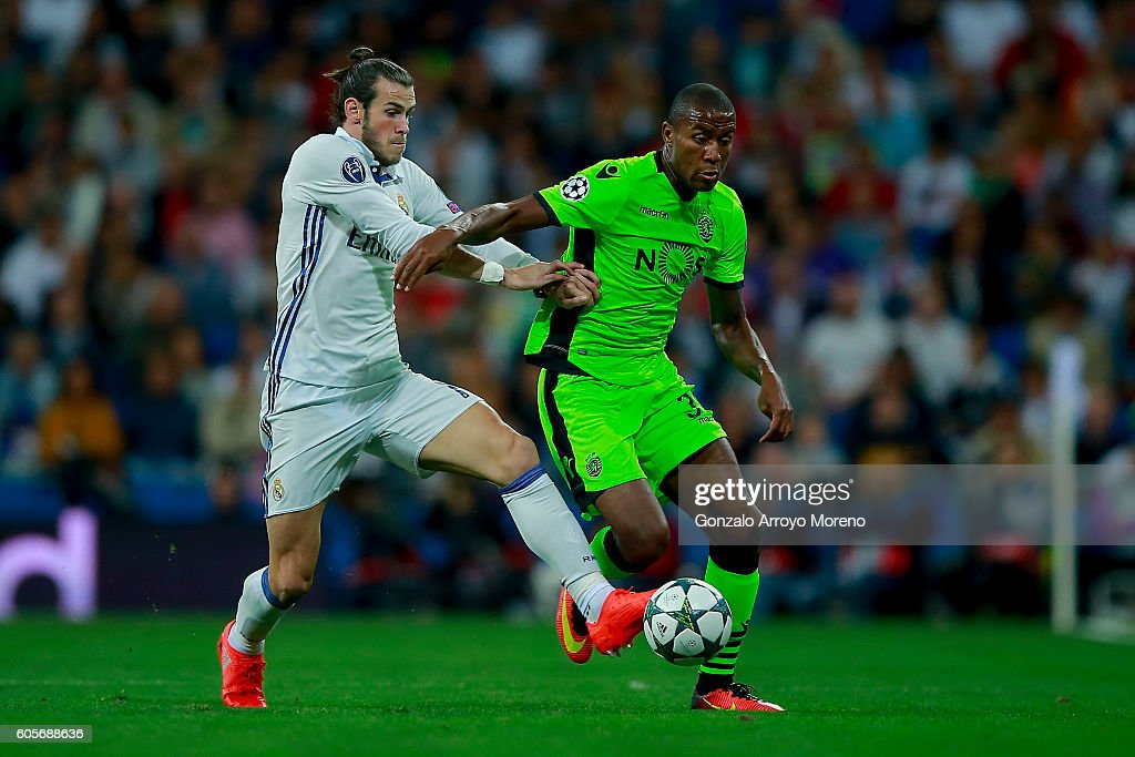 Gareth Bale (L) of Real Madrid CF competes for the ball with Marvin Zeegelaar (R) of Sporting CP during the UEFA Champions League group stage match between Real Madrid CF and Sporting Clube de Portugal at Santiago Bernabeu stadium on September 14, 2016 in Madrid, Spain.