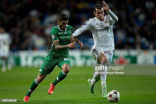 Gareth Bale of Real Madrid CF competes for the ball with Ulison de Souza Paula Junior alias Junior Caicara of PFC Ludogorets Razgrad during the UEFA...