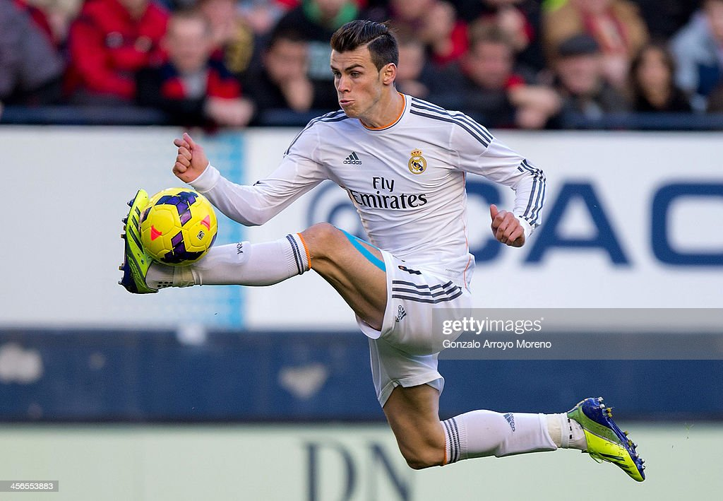 <a gi-track='captionPersonalityLinkClicked' href=/galleries/search?phrase=Gareth+Bale&family=editorial&specificpeople=609290 ng-click='$event.stopPropagation()'>Gareth Bale</a> of Real Madrid CF controls the ball during the La Liga match between CA Osasuna and Real Madrid CF at Estadio El Sadar de Navarra on December 14, 2013 in Pamplona, Spain.