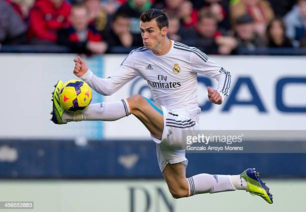 Gareth Bale of Real Madrid CF controls the ball during the La Liga match between CA Osasuna and Real Madrid CF at Estadio El Sadar de Navarra on...