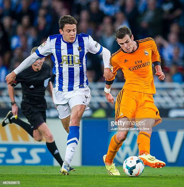 Gareth Bale of Real Madrid CF duels for the ball with Gorka Elustondo of Real Sociedad during the La Liga match between Real Sociedad and Real Madrid...