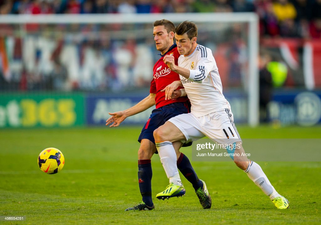 <a gi-track='captionPersonalityLinkClicked' href=/galleries/search?phrase=Gareth+Bale&family=editorial&specificpeople=609290 ng-click='$event.stopPropagation()'>Gareth Bale</a> of Real Madrid CF duels for the ball with Roberto TorresÊof CA Osasuna during the La Liga match between CA Osasuna and Real Madrid CF at Estadio Reyno de Navarra on December 14, 2013 in Pamplona, Spain.