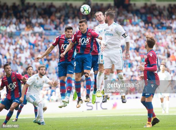 Gareth Bale of Real Madrid CF heads the ball wile being challenged by Sergio Postigo of Levante UD leaves the field after Real drew 11 in the La Liga...