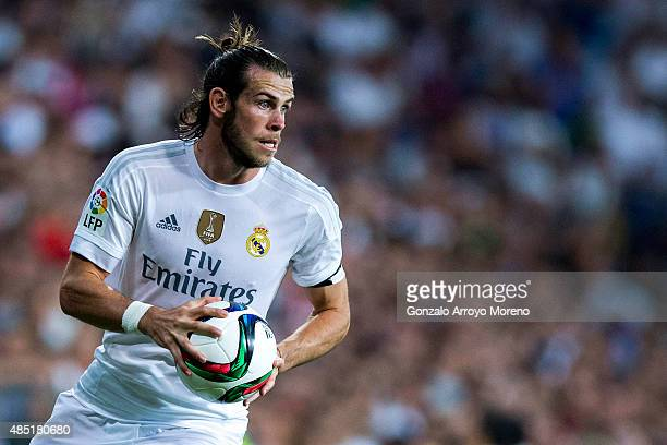 Gareth Bale of Real Madrid CF holds the ball during the Santiago Bernabeu Trophy match between Real Madrid CF and Galatasaray at Estadio Santiago...