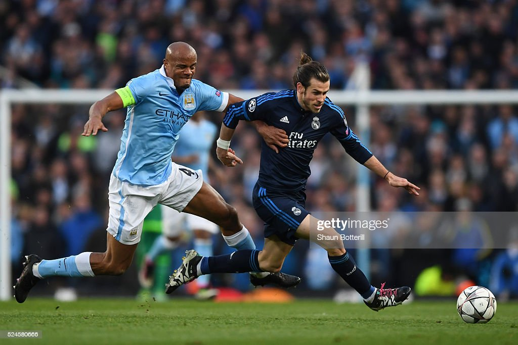 Gareth Bale of Real Madrid CF is challenged by Vincent Kompany of Manchester City during the UEFA Champions League Semi Final first leg match between Manchester City FC and Real Madrid at the Etihad Stadium on April 26, 2016 in Manchester, United Kingdom.