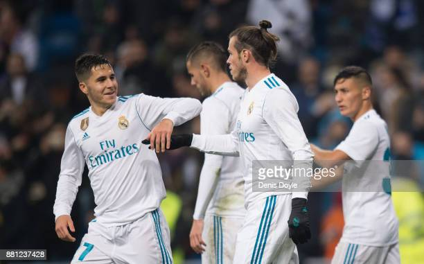 Gareth Bale of Real Madrid CF is congratulated by Alvaro Tejero after he set up Real's opening goal during the Copa del Rey Round of 32 Second Leg...