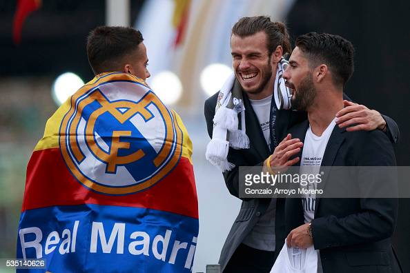 Gareth Bale of Real Madrid CF jokes with his teammates Francisco Roman Alarcon alias Isco and Lucas Vazquez during their team celebration at Cibeles...