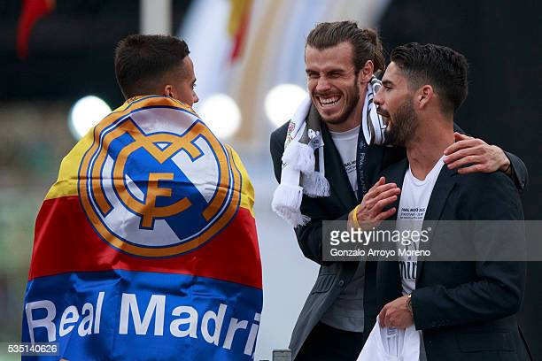 Gareth Bale of Real Madrid CF jokes with his teammates Francisco Roman Alarcon alias Isco and Lucas Vazquez during their team celebration at Cibeles...