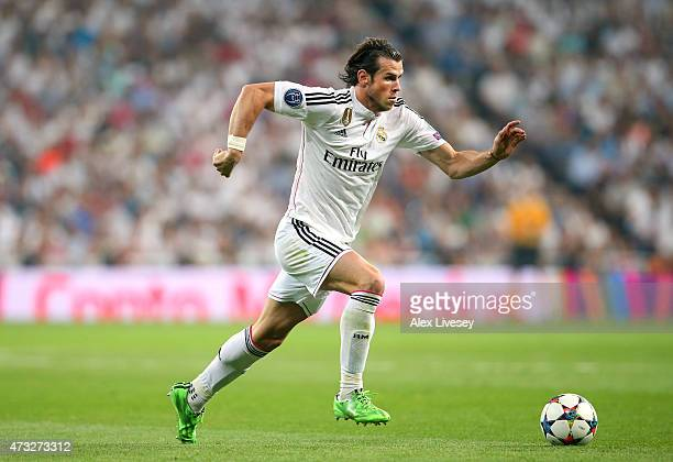Gareth Bale of Real Madrid CF runs with the ball during the UEFA Champions League Semi Final second leg match between Real Madrid CF and Juventus at...