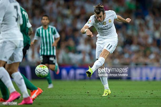 Gareth Bale of Real Madrid CF scores their fifth goal during the La Liga match between Real Madrid CF and Real Betis Balompie at Estadio Santiago...