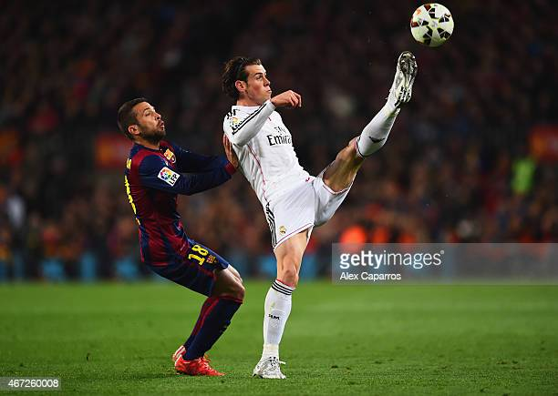 Gareth Bale of Real Madrid CF stretches for the ball ahead of Jordi Alba of Barcelona during the La Liga match between FC Barcelona and Real Madrid...
